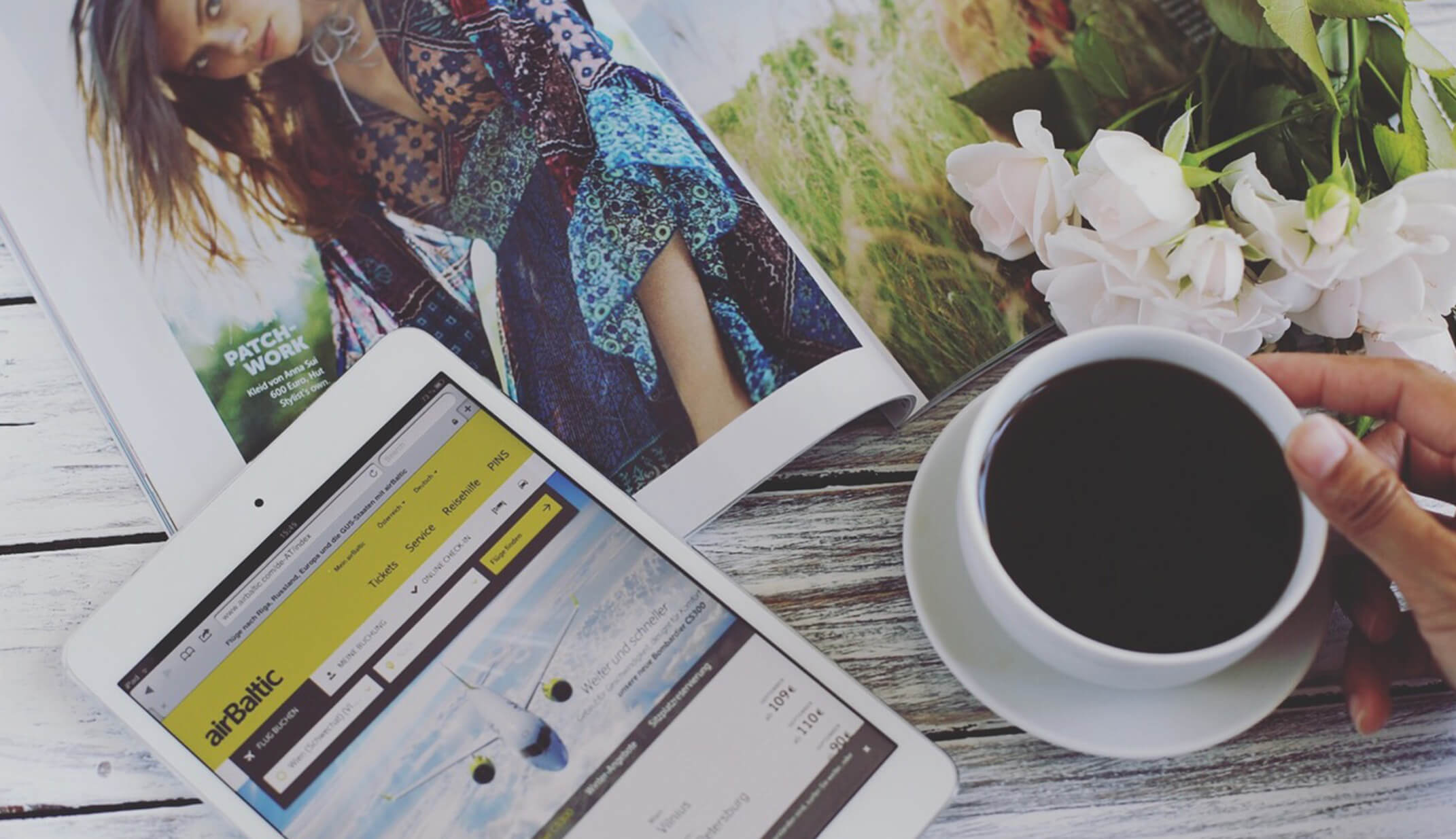 reading magazine fashion coffee passport flowers flat-lay hand fresh white branded app application travel ready planning travel real social UGC photography