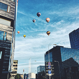town city balloons modern hot air unexpected sky view highland travel real social UGC photography