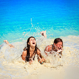 girls woman beach fun sand tropical blue sea splash real UGC travel content photography