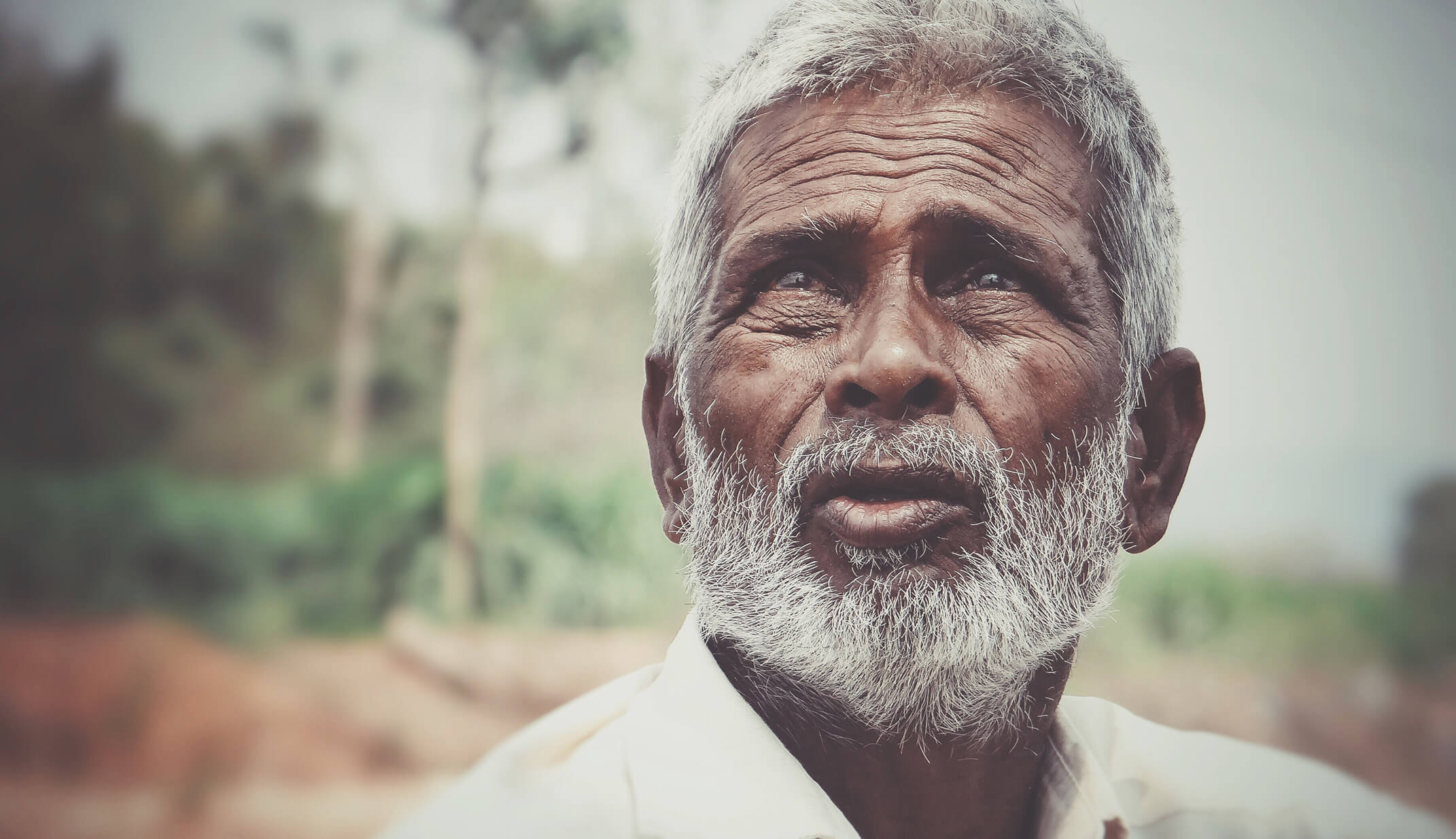 man hindu indian portrait looking background portrait landscape documentary feelings emotions sad sadness girl portrait smile asia content travel real UGC photography