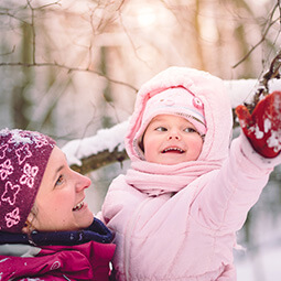 mum and daughter playing winter snow kid baby fun family moments forest pink smile UGC content